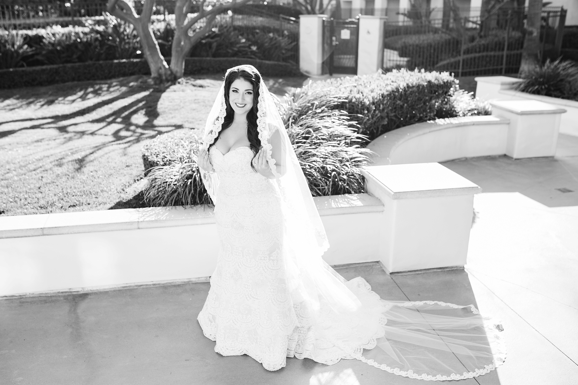 Black and White Photo of a beautiful bride with a long veil