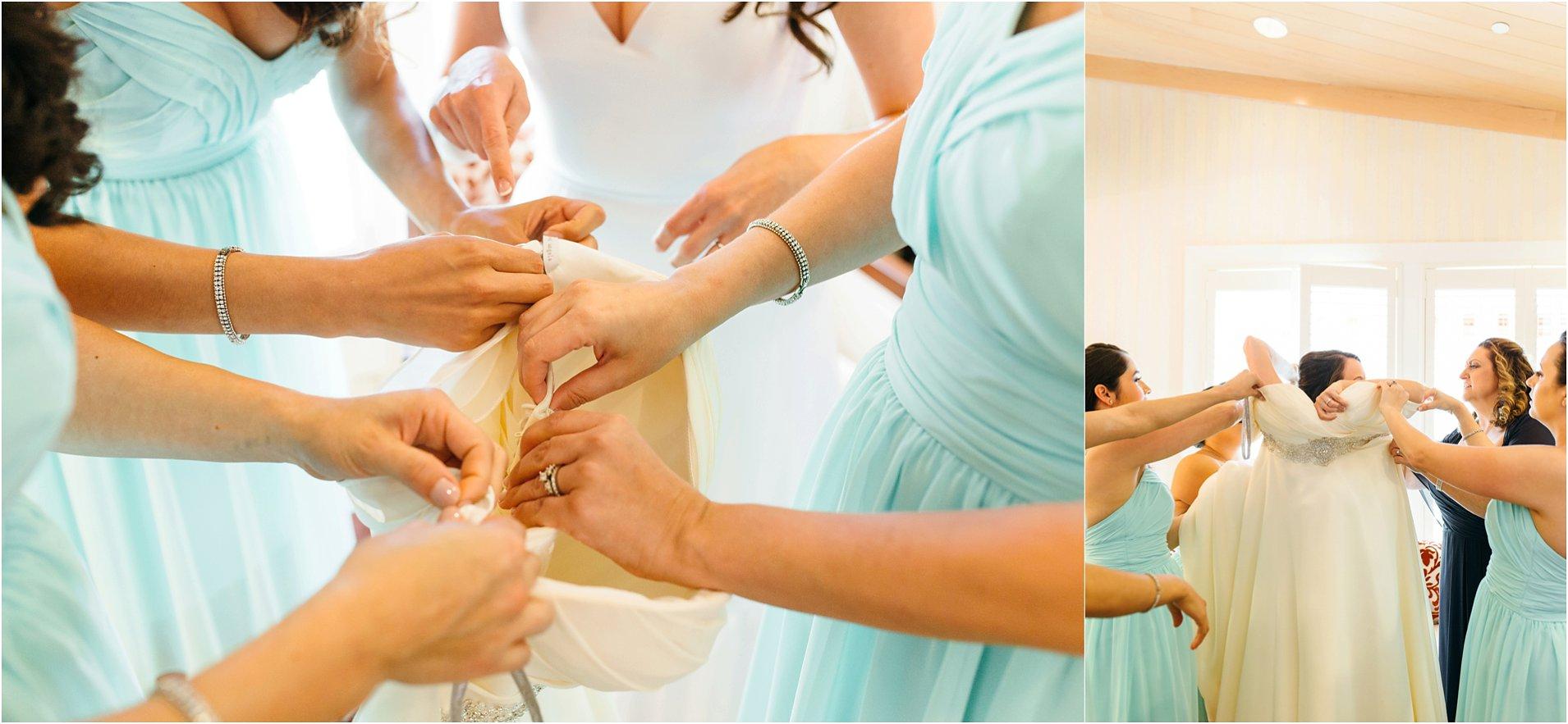 bride getting into dress at pechanga