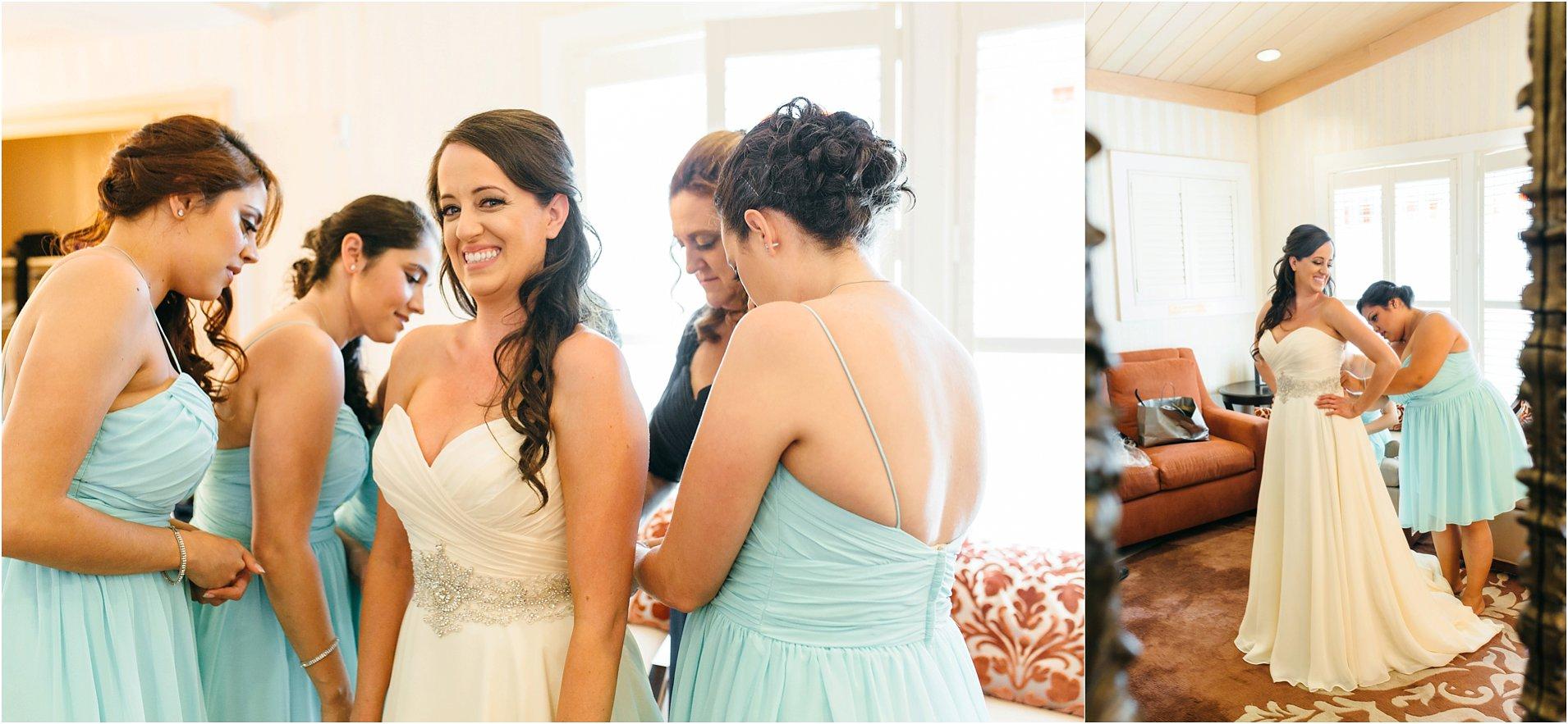 bride getting into wedding dress in temecula