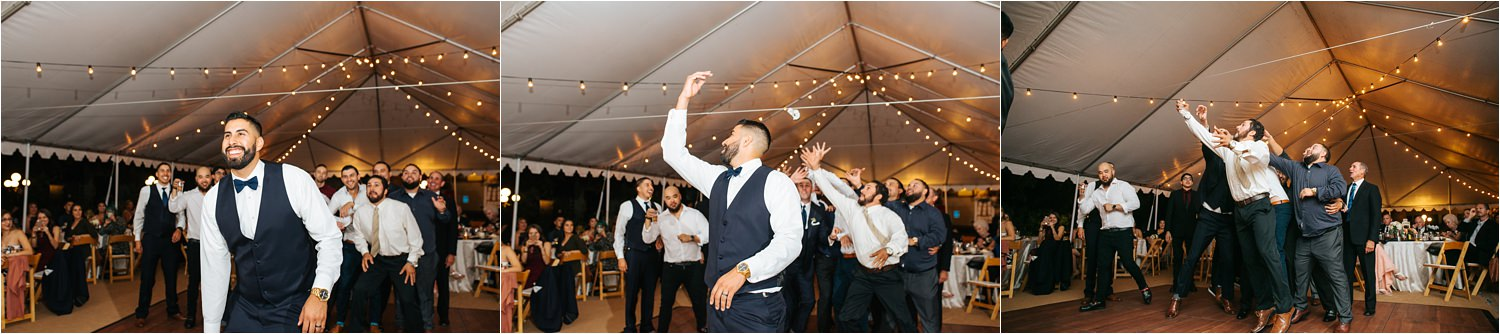 Garter Toss at the Wedding Reception - Groom tosses garter - http://brittneyhannonphotography.com