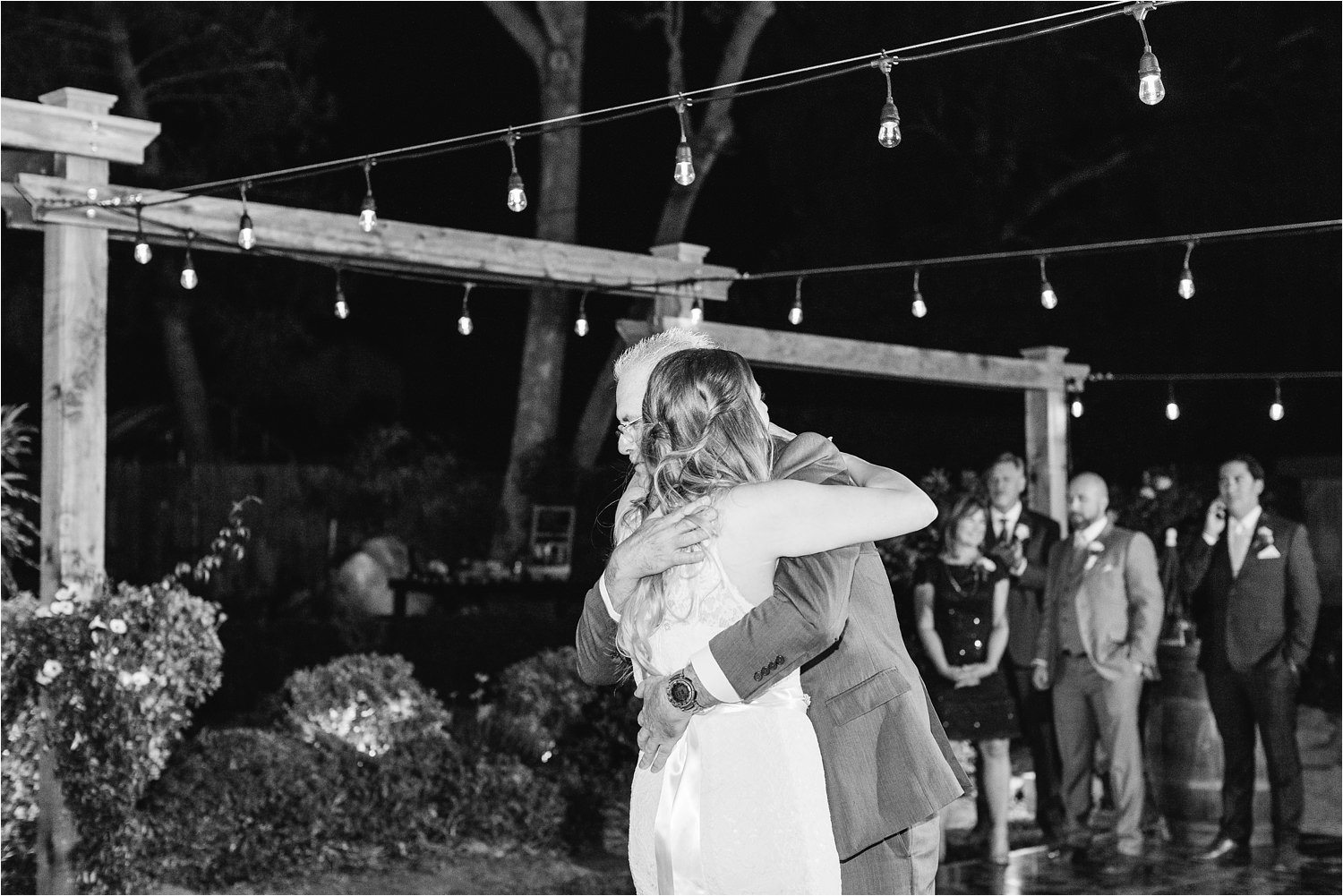 Bride gives her hug a dad during the father daughter dance - https://brittneyhannonphotography.com