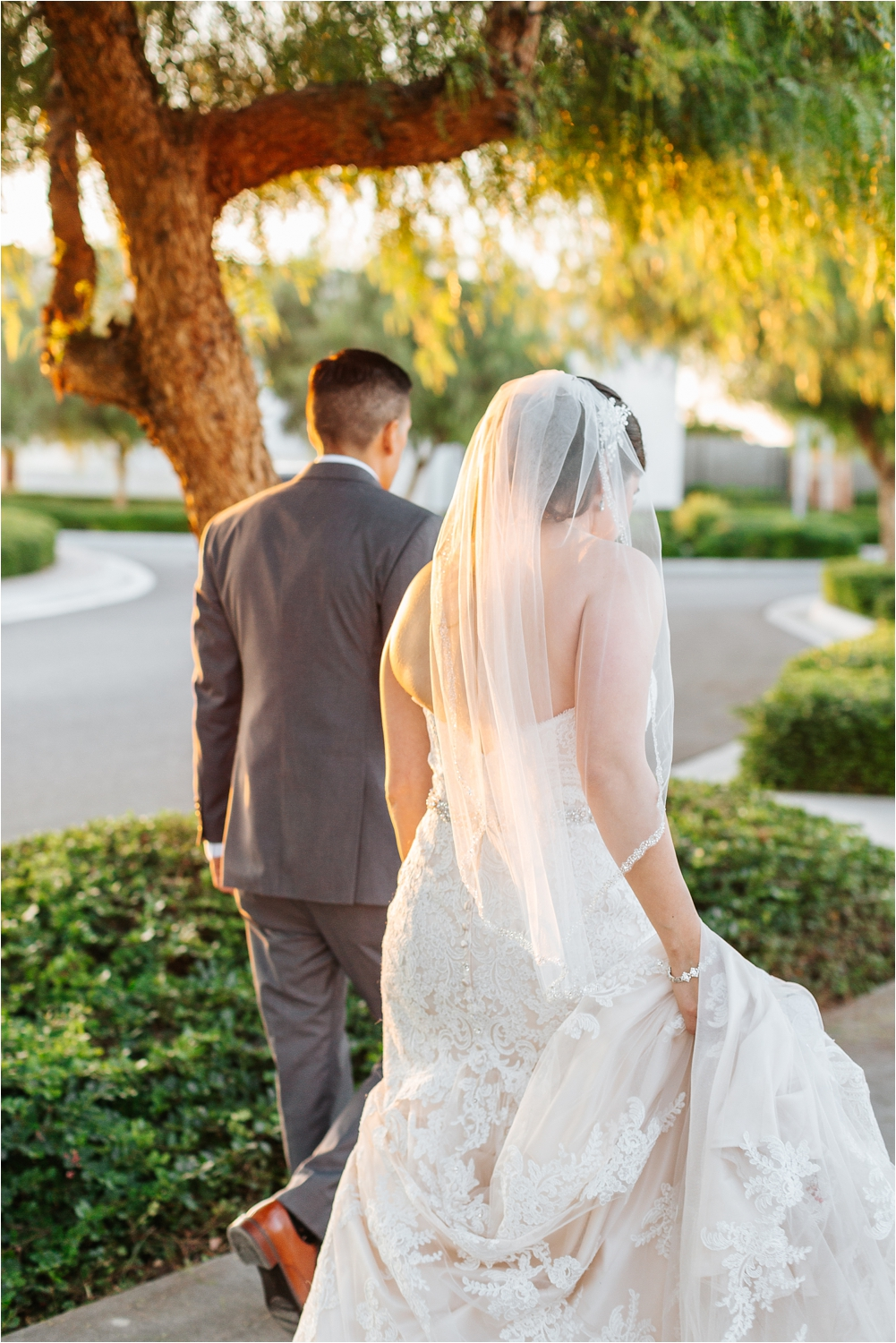 Walking at sunset - bride and groom pictures - https://brittneyhannonphotography.com