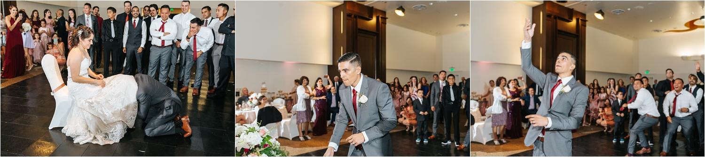 Garter Toss - Groom Tosses Garter at Wedding Reception - https://brittneyhannonphotography.com