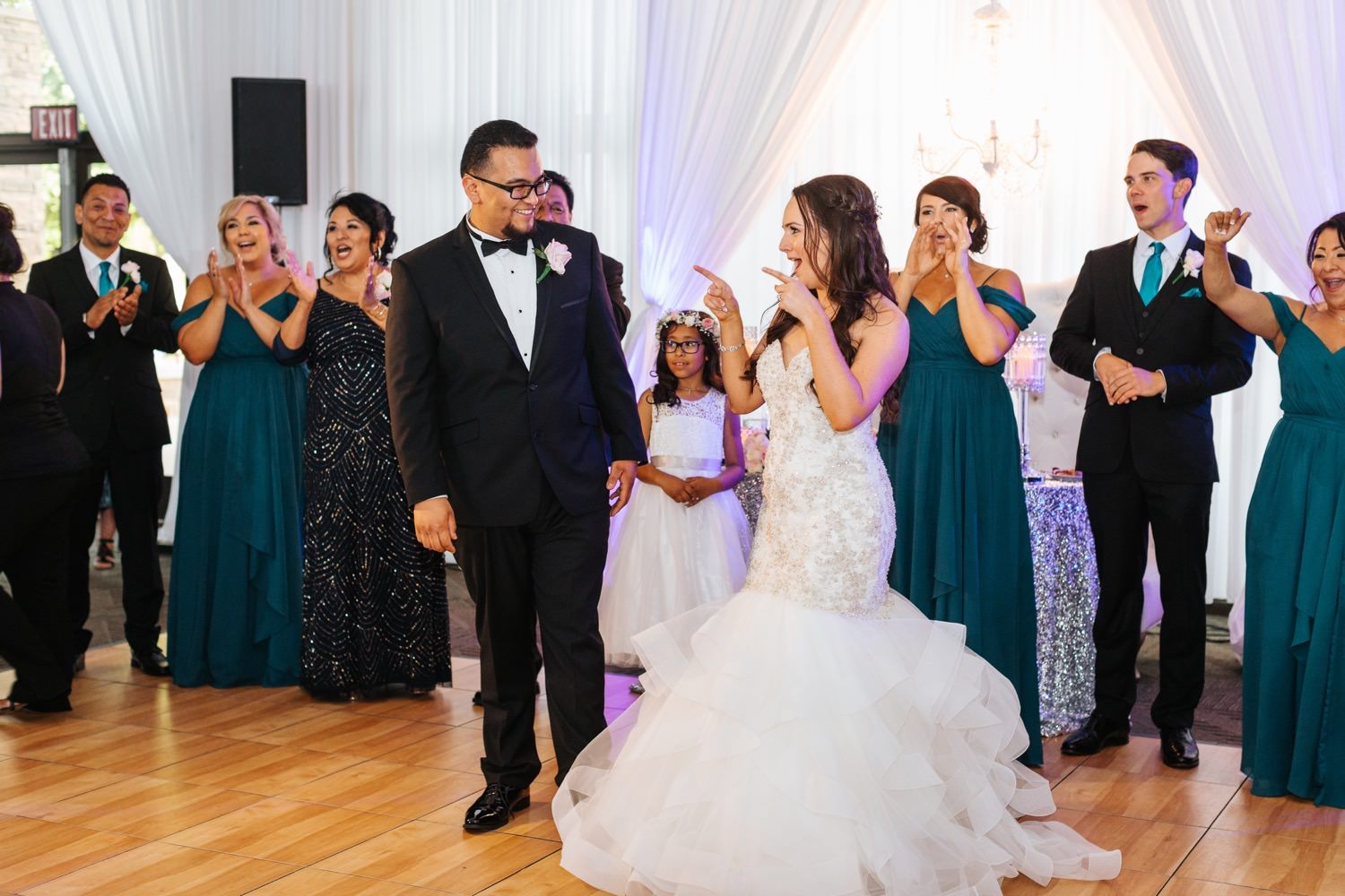 Bride and Groom make their grand entrance - https://brittneyhannonphotography.com
