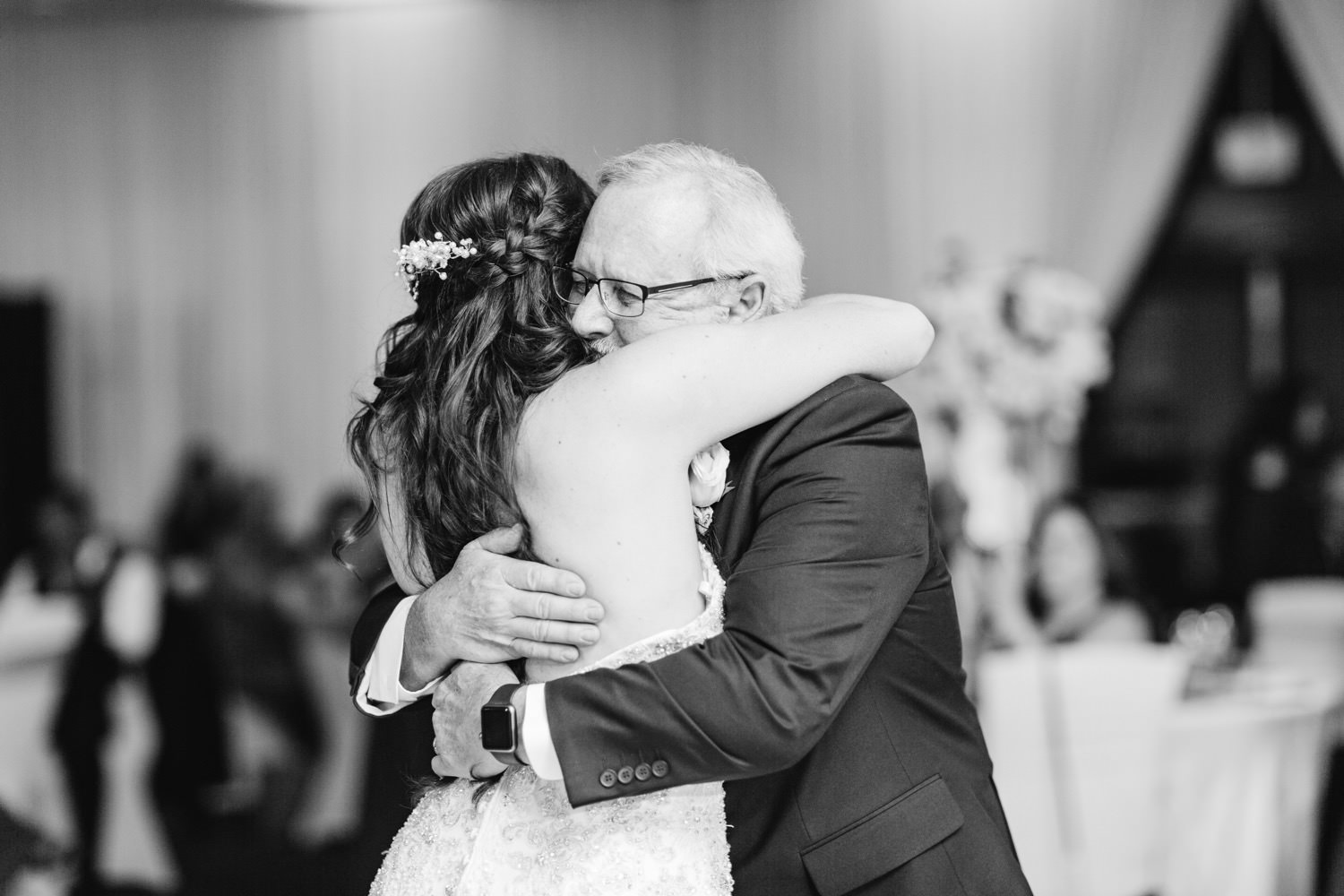 Bride hugs her dad after special father daughter dance - https://brittneyhannonphotography.com
