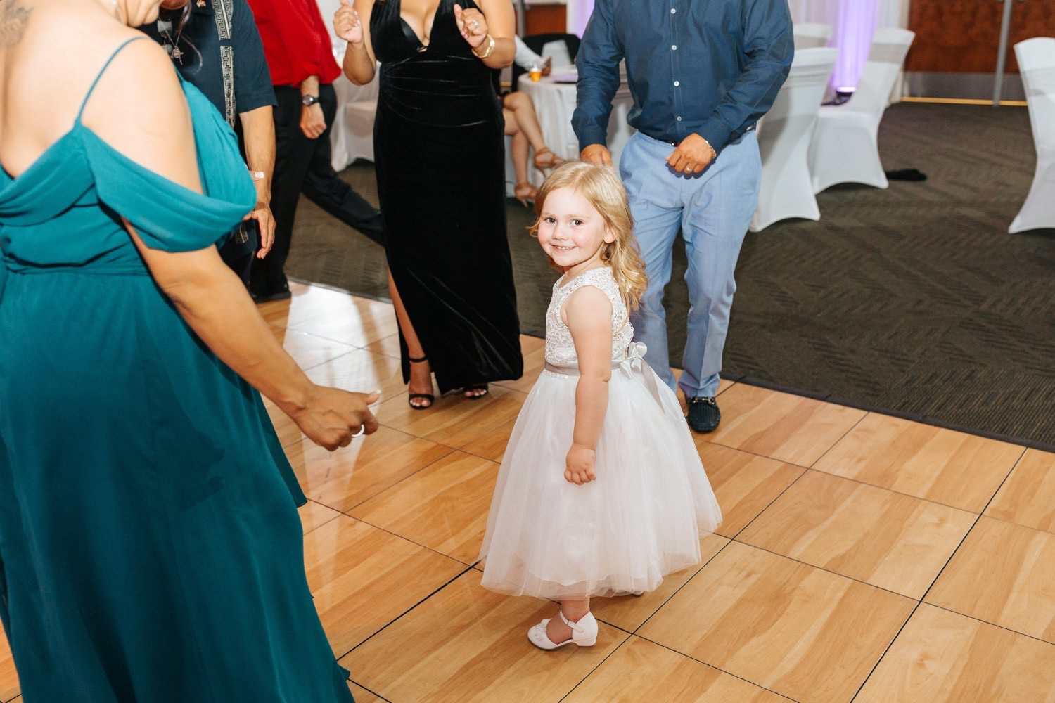 Flower girl dancing during wedding reception - https://brittneyhannonphotography.com