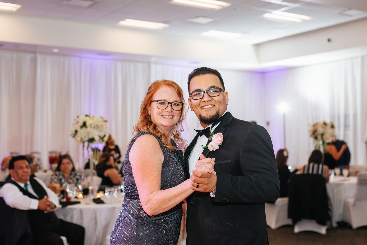 Groom dances with brides mom - https://brittneyhannonphotography.com