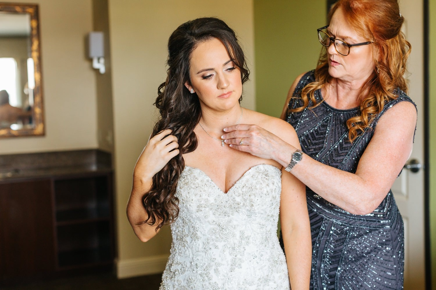 Special moment between bride and her mom - https://brittneyhannonphotography.com