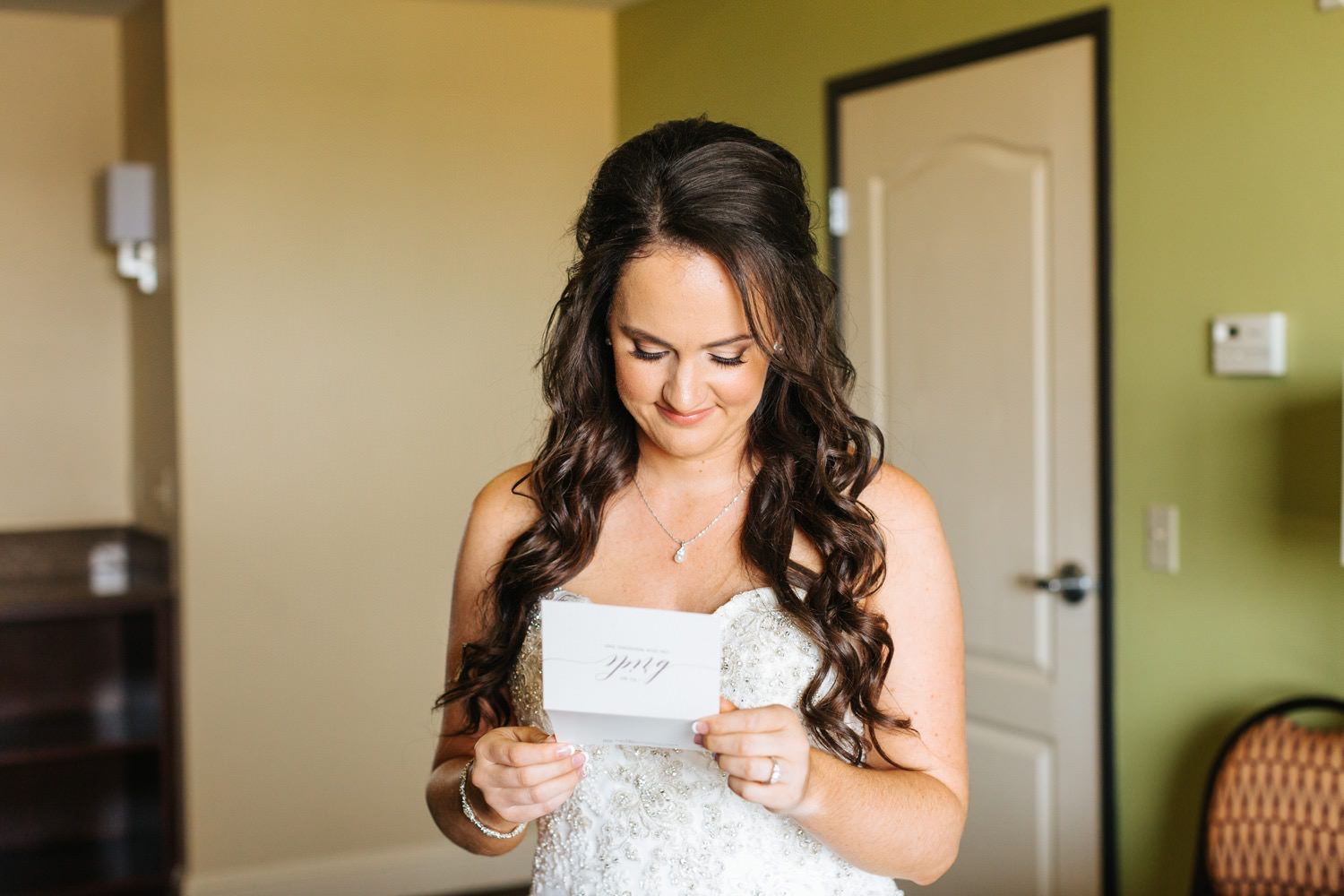Bride reading letter from groom - https://brittneyhannonphotography.com