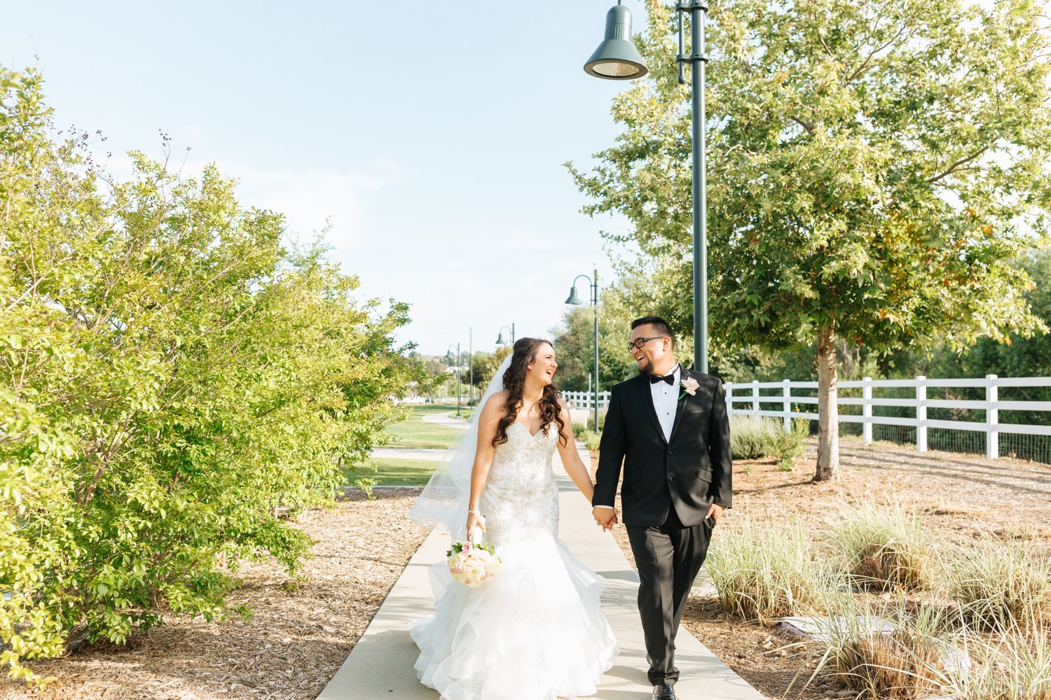 Bride and Groom Walking - https://brittneyhannonphotography.com