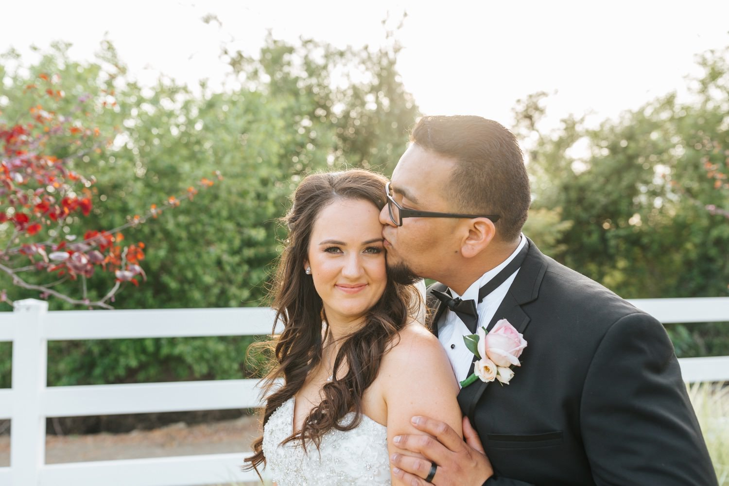 Groom kisses his bride - https://brittneyhannonphotography.com