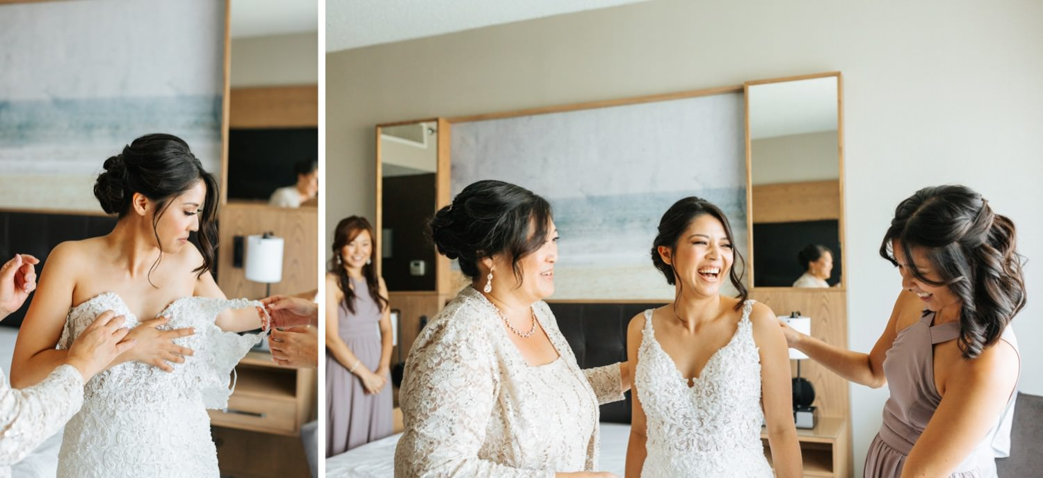 Bride's Mom and Maid of Honor helping her into wedding dress - Los Angeles Wedding Photographer - https://brittneyhannonphotography.com
