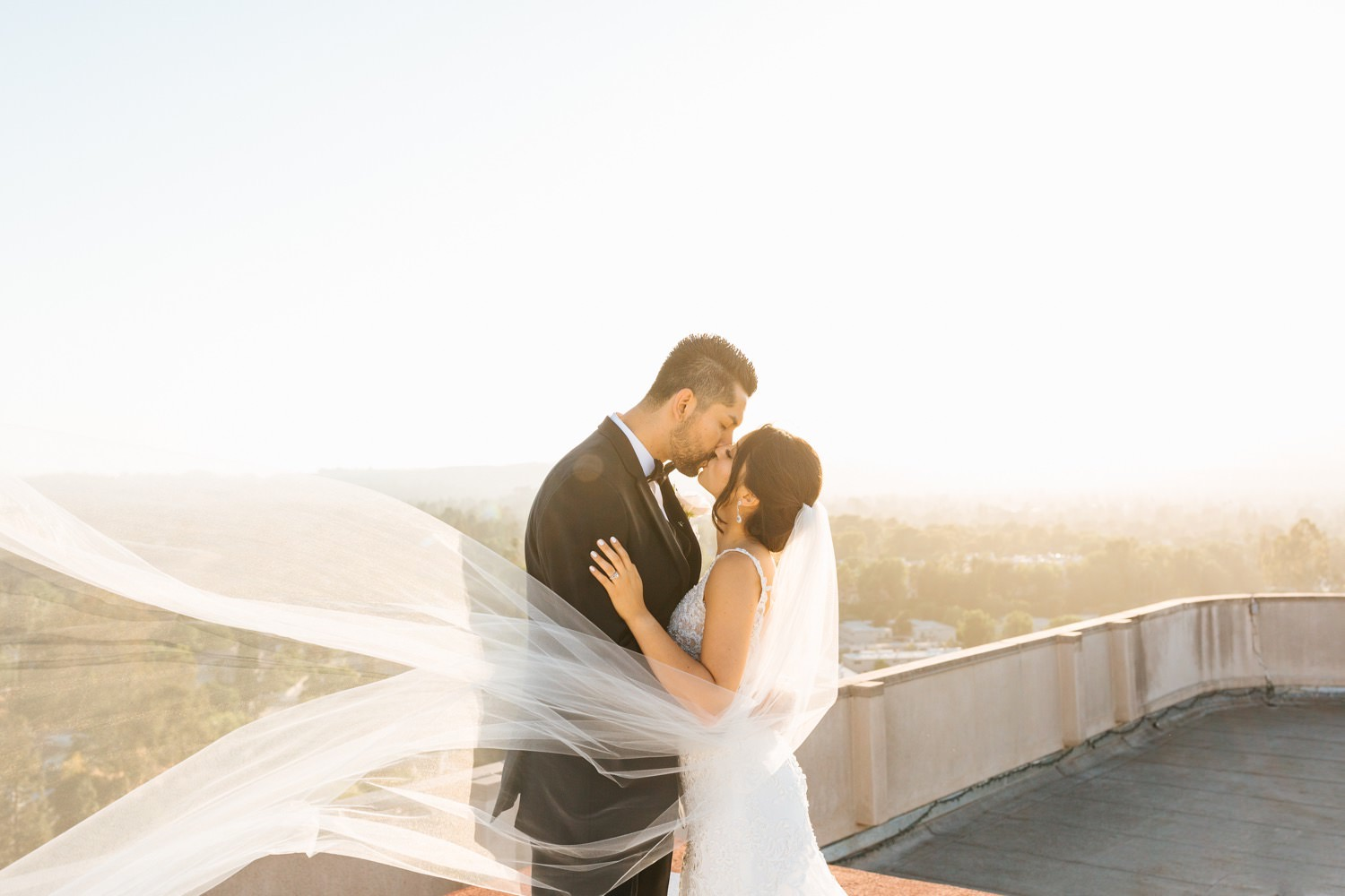 LA rooftop wedding photos - romantic bride and groom photos - veil wedding photos - https://brittneyhannonphotography.com