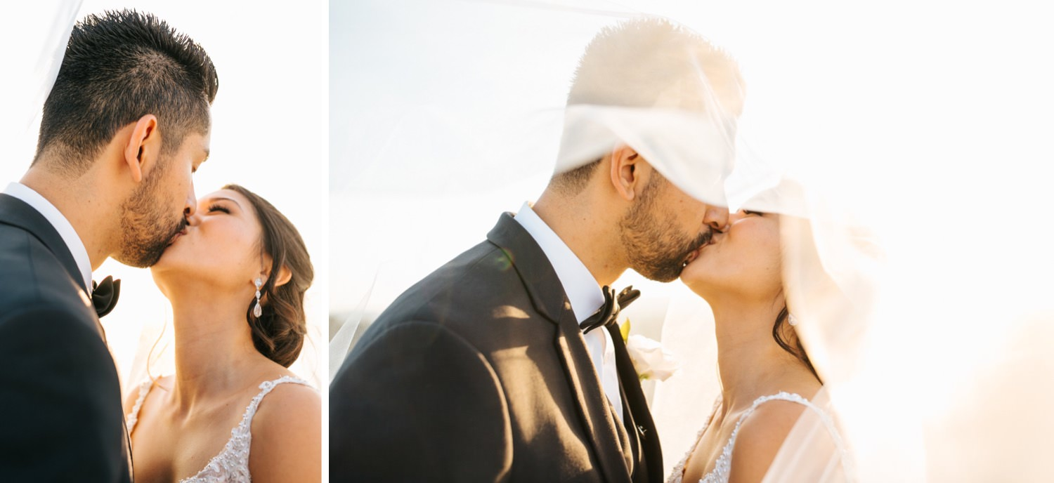 Bride and Groom kiss under veil - https://brittneyhannonphotography.com